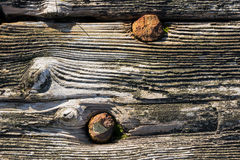 Old gray wood wall pattern. Wooden house texture. Estonian culture, architecture Royalty Free Stock Photo
