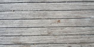 Gray wooden floor wall. Old gray wooden floor. Background photo with selective focus on foreground and shallow Stock Photos