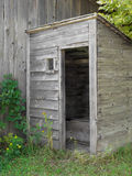 Old gray wooden outhouse. Stock Images