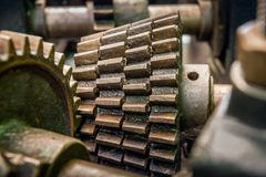 Old greasy gears from close. Closeup of greasy gears a a part of an old machine Royalty Free Stock Image