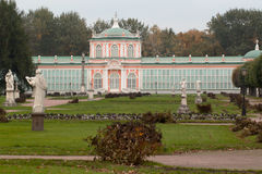 Old Great stone conservatory in the autumn park Royalty Free Stock Image