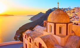 Thira town and Aegean sea at sundown stock photos