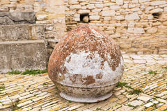 Old Greek clay jug on the street. Old Greek clay jug on stones on the street Stock Photo