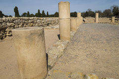 Old Greek columns ruins in Empúries Royalty Free Stock Image