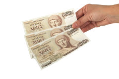 Old Greek currency of 1000 drachmas banknotes. Old Greek currency of 1000 drachmas bills isolated on white Stock Image
