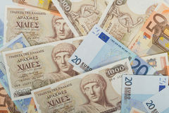 Old Greek 1000 drachmas banknotes and euro bills. Old Greek 1000 drachmas banknotes and variety of euro bills Royalty Free Stock Photo