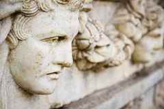Old greek face sculpture Royalty Free Stock Photography