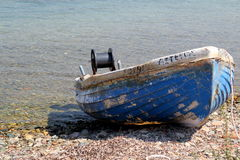 The old Greek fishing boat in the Aegean Sea Stock Photos