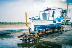 Old Greek Fishing Boat In Dry Dock Blue White Colors, Paralia Ka Royalty Free Stock Image