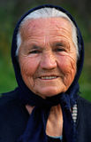 Old Greek lady. Image shows a portrait of an old Greek happy lady, wearing a scarf Royalty Free Stock Image