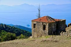 Free Old Greek Mountain Village Stone House Overlooking Gulf Of Corinth Royalty Free Stock Image - 128111896