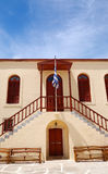 Old Greek religious building and flag Royalty Free Stock Images