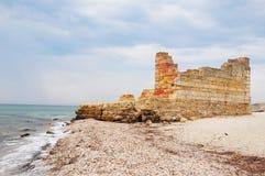 Old greek ruin on the sea coastline as global flood concept. Noah`s Flood concept. Stock Photography