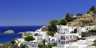 The old Greek town of Lindos. Panorama to old grecianstad Lindos and Acropolis about him. Greece. The island of Rhodes Stock Photo