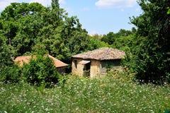 Old Greek Village House in Wildflower Field, Greece. An old diy Greek Village house or hut in a wildflower field on Mount Parnassus, Greece stock image