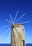 Old Greek Windmill against blue sky in Rhodes Stock Photos