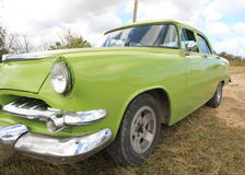 Old green american car closeup. Stopped in the grass, Cuba Royalty Free Stock Images