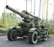 Old green artillery field cannon gun Stock Images