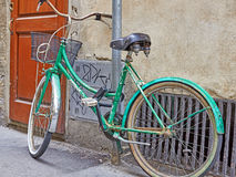 Old green bicycle Stock Image