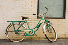 Old Green Bike on Brick Wall Royalty Free Stock Photo