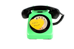 Call mom. Old green and black rotary phone with a heart shaped post-it reminder to call mom Royalty Free Stock Photo