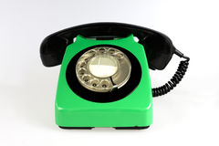 Green rotary phone  on white. Old green and black rotary phone  on white Royalty Free Stock Photos