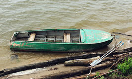 Old green boat with oars Stock Photos