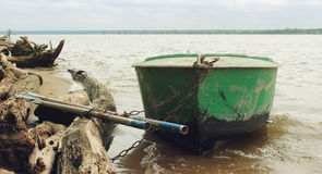 Old green boat with oars Royalty Free Stock Images