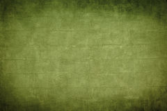 Old green brickwall with dark vignette borders Stock Image
