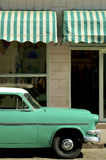 Old green car. Parked in a typical street of Cienfuegos Stock Images