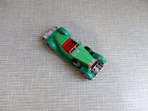 An old green car model on a gray background Stock Images