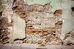 Old green cement and brick wall texture Stock Photos