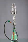 An old green ceramic hookah on a grey background Royalty Free Stock Photo