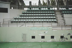 Old green coliseum,old sitting ,tennis court Stock Image