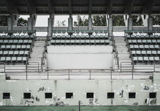 Old green coliseum,old sitting ,tennis court Stock Photos