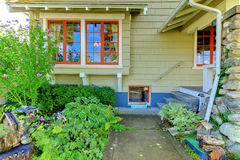 Old green cute craftsman style home. Royalty Free Stock Image