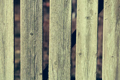 Old green distant boarded fence Stock Images