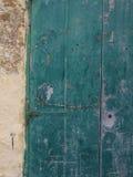 Old green door. Crumbilng old green paited door Royalty Free Stock Images