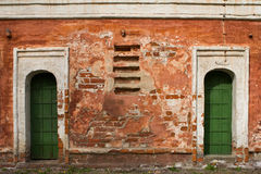 Old green door of brick building. Old green door of red brick building Stock Photos