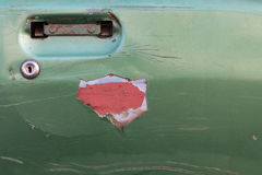 Old green door car disintegrated. Close-door car which damaged the old green moldy and peeling paint until you see the red interior Royalty Free Stock Images