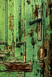 Old green door close-up with handle Royalty Free Stock Image