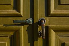 Old green door close-up with handle royalty free stock photo