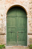 Old green door. Old gate located at the entrance of a medieval castle Stock Image