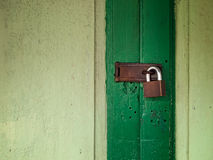 Old green door lock. With old key Stock Image