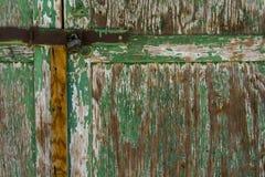 Old green door with a padlock Royalty Free Stock Photos