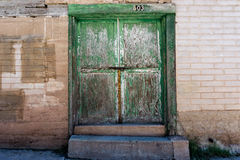 Old green door with a padlock Stock Image