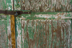 Old green door with a padlock Royalty Free Stock Image