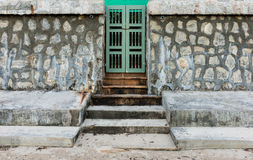 Old green door and stone wall Stock Photos