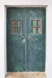 Old green door on the streets. Royalty Free Stock Images