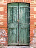 Old, green door in Tuscany Stock Photography